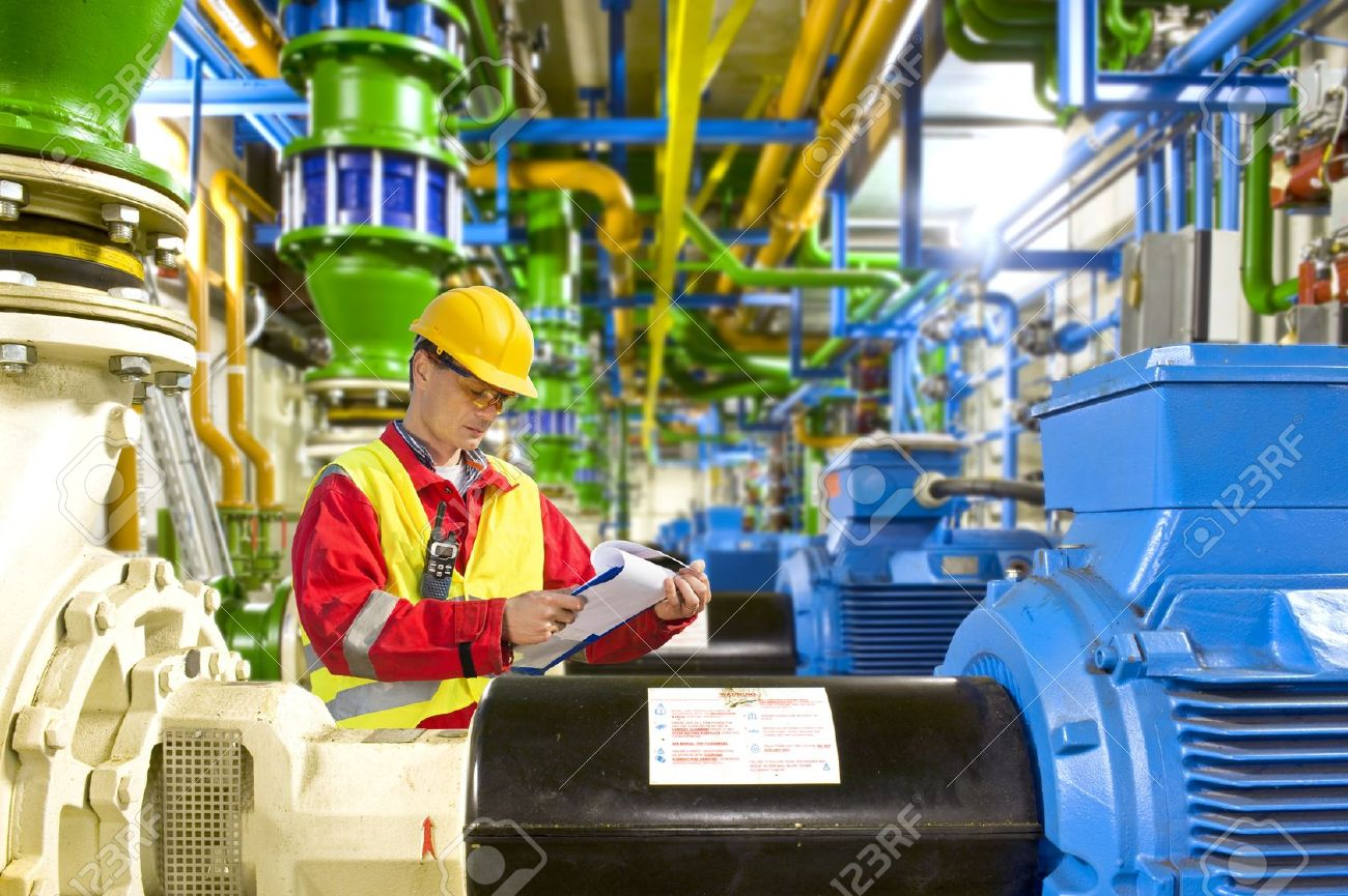 13903778-Engineer-looking-aty-a-checklist-during-maintenance-work-in-a-large-industrial-engine-room-Stock-Photo.jpg